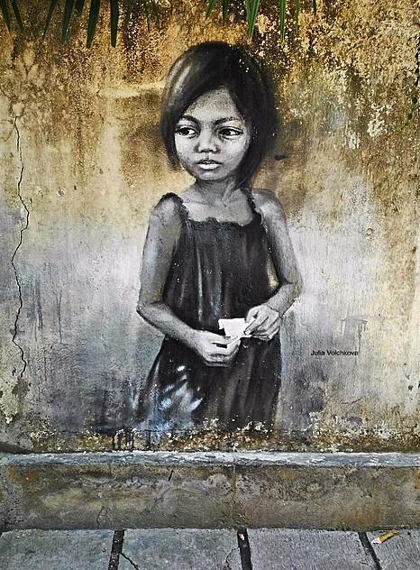 Artist Julia Volchkova endearing photorealistic Street Art portrait located in Bali Indonesia